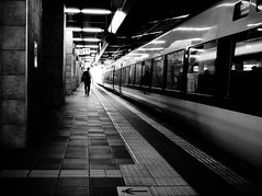 Platform 11 (明遊快) Tags: train station monochrome bw japan osaka dark lights shadows sunlight contrast lines 20年祭