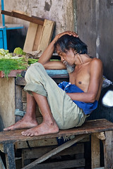 Indonesian man sleeping in market in Chinese neighborhood in Jakarta , Java, Indonesia (Alex_Saurel) Tags: homme asia culture indigenous vacances indigène asie portrait portray jakarta man java indonesia indonésie voyage sleeping 85mmf28sam