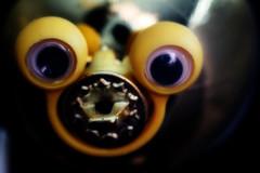 ET? (PaulE1959) Tags: macromondays christmas ball decoration shiny gold eyes toy macro nikon d5200 aprilfools