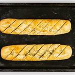 Flat lay above baked Bread Bruschetta on the baking tray thumbnail