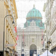 Grandeur (halifaxlight) Tags: austria vienna hofburgpalace architecture lamps flags decortions lights street buildings shops square dome