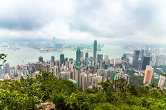 Hong Kong overlook (gstening) Tags: hongkong vacation varm vinter view city mega cityscape victoria peak victoriapeak cloudy clouds blue sky greens forest green water sea skyscraper skyscrapes asia fog hill tram landmark land mark big