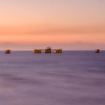 A shot of an oil facility  in Bacolod during sunset thumbnail
