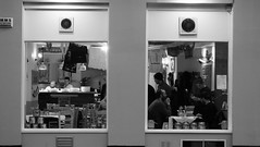 As Night Falls Its Time To Feed (byronv2) Tags: edinburgh edimbourg edinburghbynight night nuit nacht blackandwhite blackwhite bw monochrome window peoplewatching candid street dalry dalryroad haymarket pizzeria cafe diner restaurant dining eating naples pizzeria1926