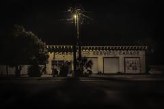 Florida Gas Station 1 (jessicalowell20) Tags: florida black closed cream dark gasstation gray green gulfcoast haze light lightpole night palm road shadow thesouth tree utilitylines winter