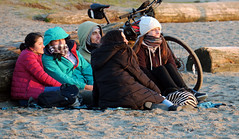Winter Sunset Watchers (HereInVancouver) Tags: thingstodobythewater candid sand beach log bicycle people outdoors city urban vancouverswestend canong3x englishbaybeach vancouver bc canada