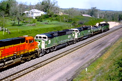 The shove up the hill at Crawford,NE. in 2005 (THE RESTLESS RAILFAN) Tags: nebraska crawford hill bn triclops green white orange black 9219 5668 fuel tankcar