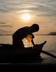 Child Boatman (jbrad1134) Tags: child boat outrigger canoe sea ocean travel sunset yellow warm water coron philippines adventure shadows portrait asia silhouette afternoon golden