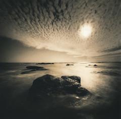 Terra (micalngelo) Tags: analog filmphoto darkroom sepiatoned seascape pinholecamera realitysosubtlepinhole mediumformatphotography fomapan100film toycamera toycameraphotography lomography lomojunkie sunray