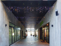 Twinkling (Steve Taylor (Photography)) Tags: mall corridor speaker potplants netlights architecture concrete tile newzealand nz southisland canterbury christchurch cbd city plant perspective