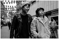 whistle while you walk (Silver Machine) Tags: london chinatown chineselanterns streetphotography street candid couple walking leatherjacket bakerboycap beanie blackwhite bw mono monochrome fujifilm fujifilmxt10 fujinonxf35mmf2rwr