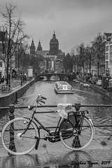 How tourists look at Amsterdam (Stephan Neven) Tags: amsterdam bicycle tour boat canal basilica rainy bridge black white bw photography blackandwhite capital typical postcard netherlands dutch redlightdistrict