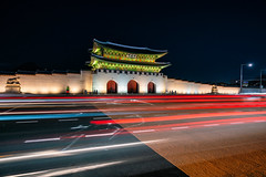 Light trails of car at front of Gyeongbokgung Palace illuminated at twilight scene in Seoul city, South Korea. (MongkolChuewong) Tags: gwanghwamun ancient architecture art asia autumn backpack backpacker beautiful blue building castle city culture entrance fashion garden gate gateway girl grounds gyeongbokgung hanbok historic historical illuminated korea korean kwanghwamun landmark national night old palace royal seoul south spring style summer sunrise sunset sy tourism tourist traditional travel traveler twilight woman