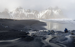 Stokksnes (Dell's Pics) Tags: blue stokksnes east iceland beack black sand man photographer mountainshills misty fog sea ocean water