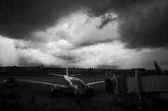 ominous clouds (peaceblaster9) Tags: airport airplane sky clouds sunlight terminal rain sanjose california departure ricoh ricohgr2 gr2 blackandwhite bnw bw blackwhite 空港 飛行機 空 雲 雨 雨雲 出発 サンノゼ カリフォルニア 白黒 モノクローム モノクロ