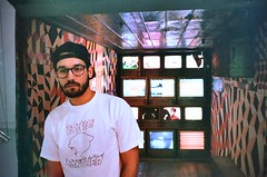 (youngkurama) Tags: themarguliescollection thewarehouse miami florida art exhibitions photography gallery wynwood artdistrict film 35mm canon canonrebel february 2019 life traveling shooters casey portrait rarepanther televisions lights lighting colors indoors