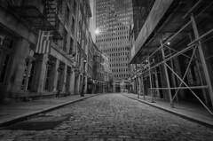 """One of New York's Oldest Streets"" (Photography by Sharon Farrell) Tags: stonestreet manhattan financialdistrict newyork newyorkcity nyc stonestreethistoricdistrict oneofnewyorksoldeststreets highstreet hooghstraet nieuwamsterdam dukestreet cobblestonestreet cobblestonepaving lowermanhattan historicstonestreet blackandwhite noiretblanc bw nyclpc newyorkcitylandmarkspreservationcommission landmark"
