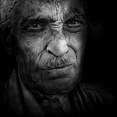 Man looking thoughtful (Ales Dusa) Tags: man portrait blackandwhite bwportrait outdoor streetshot human humanity wrinkles strongcontrast moustache alesdusa canon fullframe oldman face people candid charisma monochrome streetportrait eyecontact bestportraitsaoi greyscale