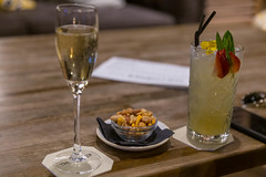 Sparkling wine, cocktail, mobile phone and small bowl of nuts on a rustic wooden table in the lounge and bar of The Corner Hotel in Barcelona, Spain (verchmarco) Tags: spain barcelona spanien wine wein noperson keineperson drink getränk glass glas champagne champagner party food lebensmittel alcohol alkohol celebration feier icee fruit obst vacation urlaub summer sommer dining essen cold kalt cocktail whitewine weiswein toast table tabelle stilllife stillleben path mono countryside harbour feet dusk shop windows coth5 christmastree