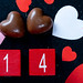 Background with chocolates and date 14 for Valentine's day