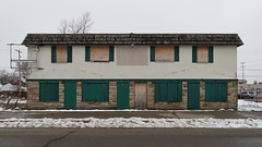 A commercial building from the year 1953! We are in eisenhower times again. (Tim Kiser) Tags: commercialandresidential december2018 nonsign clarestreet plywood 1953 20181201 concretemasonry lansingchartertownship paintedconcreteblockbuilding emptysignframe darkgreenpaint vacantbuilding fakeshutters greaterlansing midmichigan phonyshutters signlesssign snow boardedupbuilding centralmichigan lansingtownship barwithupstairsapartment 1953architecture darkgreen 1950scommercialbuilding commercialbuilding stoneveneer rustbelt concreteblockbuilding 1953building inghamcounty 1950s december shingleoverhang boardedwindows img2682 shingles abandonedbuilding inghamcountymichigan fakemansardroof 2018 emptysign overcast cloudy michigan boardedup bar boardedupwindows dirtysnow capitalregion 1950sarchitecture phonymansardroof paintedconcretemasonry southcentralmichigan formerbar barwithapartmentupstairs boardeddoors lansing lansingmichigan 1950sbuilding lansingchartertownshipmichigan lansingtownshipmichigan lansingmetropolitanarea