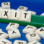 Close up shot of Exit word formed from scrabble thumbnail