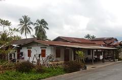 'Normal' Luang Prabang Housing (mikecogh) Tags: luangprabang housing normal road average tin corrugatediron roofs veranda