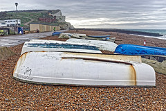 Jolly Lady & Boy's Outing (Croydon Clicker) Tags: beach shingle boat huts sea sky ocean cloud cliff hill seaford eastsussex