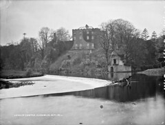 The castle at the Salmon Leap! (National Library of Ireland on The Commons) Tags: robertfrench williamlawrence lawrencecollection lawrencephotographicstudio thelawrencephotographcollection glassnegative nationallibraryofireland leixlipcastle leixlip cokildare riverliffey weir countykildare castle salmonleap demesne riverrye river ryewater boathouse