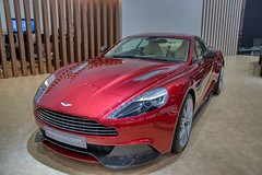 Red Aston Martin Vanquish Coupe at the 40th Bangkok International Motor Show at IMPACT Challenger hall in Muang Thong Thani, Nonthaburi (UweBKK (α 77 on )) Tags: 40 40th bangkok international motor show expo exhibition fair impact challenger hall muang thong thani nonthaburi thailand southeast asia sony alpha 77 slt dslr red aston martin vanquish coupe luxury sports car auto automobile automotive