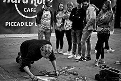 Painting the Street (garryknight) Tags: sony a6000 on1photoraw2018 london themonoseries monochrome blackandwhite group watching streetartist pavementartist street candid