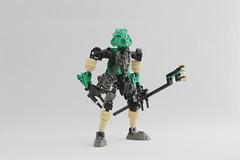 Jorwise (Ron Folkers) Tags: lego bionicle moc technic green black tan staff gunmetal traveling explorer
