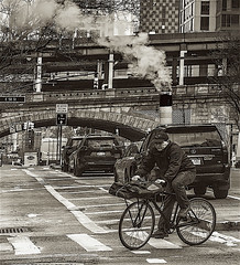 """Street Scene Along 1st Avenue and 57th Street Manhattan (nrhodesphotos(the_eye_of_the_moment)) Tags: dsc43643001084 """"theeyeofthemoment21gmailcom"""" """"wwwflickrcomphotostheeyeofthemoment"""" monochrome streetscene road bike biker transportation bicycle steam overpassqueensborobridge stone autos cars reflections shadows stores signs glass metal windows streetlights outdoors wheels spokes man perspective bikelane eastside manhattan nyc crosswalk buildings architecture"""