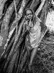Two Bladed (Rod Waddington) Tags: africa african afrique afrika äthiopien ethiopia ethiopian ethnic ethnicity etiopia ethiopie etiopian omovalley omo omoriver outdoors outdoor suri tribe traditional tribal culture cultural boy blades blackandwhite mono monochrome