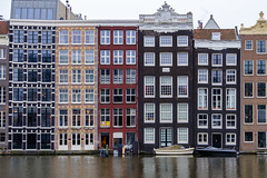 Damrak (kwphotos.com) Tags: dutch architecture buildings water canal damrak amsterdam holland netherlands homes waterfront boats colorful fuji fujifilm 18135 kwphotos