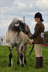 Nibble (meniscuslens) Tags: horse pony grass bucks county show event arena lady woman hat grey gray sky clouds buckinghamshire aylesbury weedon