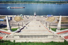 View of the Volga River and the Chkalovsky Staircase (Dmitry Yelloff) Tags: nizhnynovgorod volgariver chkalovskystaircase russia city town urban streets architecture water port quay embankment seafront waterarea ship barge bulkcarrier cargo drycargoship sailingship landmark tourism tourists national showplace summer day people cars road holiday column step transport