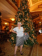 Holiday Leftovers (Laurette Victoria) Tags: xmas tree woman blouse skirt hat silver laurette hotel lobby milwaukee pfisterhotel pose