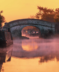 Misty Canal (Cleomedes87) Tags: sunrise sun sunset orange mist misty fog foggy river water canal bridge architecture uk england britain beautiful calm still barge narrowboat morning earlybird landscape sky skyporn pink orangesky dawn peaceful