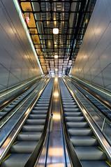 Escalators 2 (genf) Tags: central centraal station amsterdam escalators roltrap roltrappen ceiling plafond sony a99ii light licht lampen reflections weerspiegelingen indoor binnen public traffic openbaar vervoer