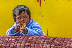 Yellow (Andrea Gambadoro) Tags: yellow child portrait colour peru lake titicaca pros community folk folklore floating island photography photographer street camera canon 5d markiii