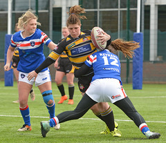 Caught In The Middle (Feversham Media) Tags: yorkcityknightsladiesrlfc wakefieldtrinityladiesrlfc womenssuperleague rugbyleague york womensrugbyleague yorkstjohnuniversity