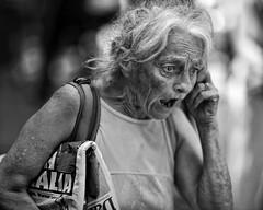 Warner returns (gro57074@bigpond.net.au) Tags: newspaper dailytelegraph news 2018 december monotone mono monochrome bw blackwhite 105mmf14 artseries sigma d850 nikon sydney emotion shock woman guyclift streetphotography candidstreet candid