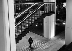 (Spannarama) Tags: lookingdown highwalk london uk blackandwhite stairs evening lowlight dark litup illuminated man walking pillars columns