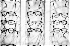 Glass eyes (Logris) Tags: glasses glas brille brillen sw bw detail