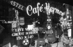 Café Hermes (Arne Kuilman) Tags: amsterdam nikon fm3a vivitar 28mm luckyshd iso100 id11 7minutes homedeveloped stock analogue film caféhermes window ruit bruinekroeg kroeg