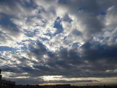 Sun through dark clouds (seikinsou) Tags: brussels belgium bruxelles belgique autumn sun cloud sky wind skyline