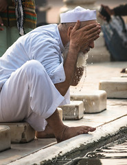Bathing at the Mosque 1 (Wits End Photography) Tags: mosque man streetphotography adult delhi guy india reflection male travelphotography street people washing places men drive pavement road roadway route