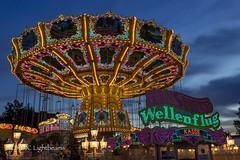 Merry-go-round (NORDIC Lightbeams) Tags: blauestunde ed1240mmf28 dom jahrmarkt deutschland hamburg germany norddeutschland northgermany olympuszuiko stadt bluehour city funfair mft microfourthirds de