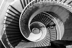 Spiral (ewitsoe) Tags: analog analogue bnw blackandwhite cityscape monochrome nikonfm2 polska rolleisuperpan200 spring street warszawa erikwitsoe erikwitsoecom everydaylife mono poland urban warsaw lookingdown spiral staircase light shadows travel mood people walking perspective